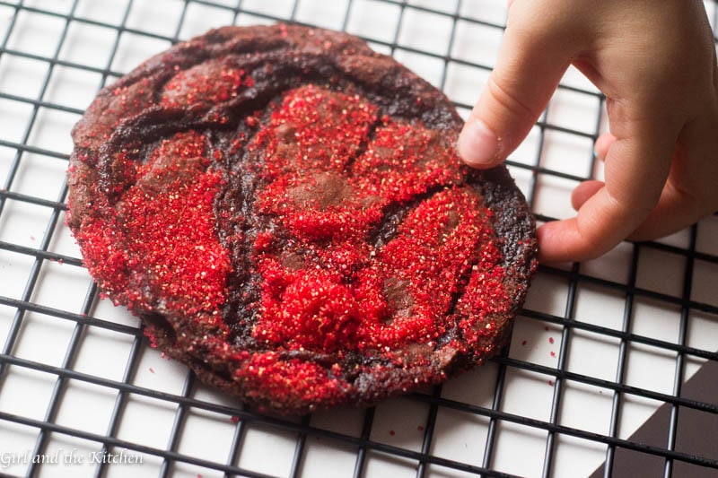 Meet the one bowl Chocolate Nutella Cookies that is a cinch to make but dazzles everyone! It is the ultimate holiday cookie filled with chocolate and Nutella. Gorgeous sparkles and delicate crinkles make this cookie a show stopper for any holiday that needs a bit of dazzle
