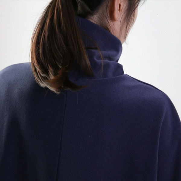 Turtleneck Batwing Sweater worn by a model turned on her back