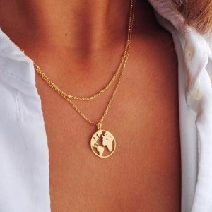 World Map Gold Necklace worn by a model in close up
