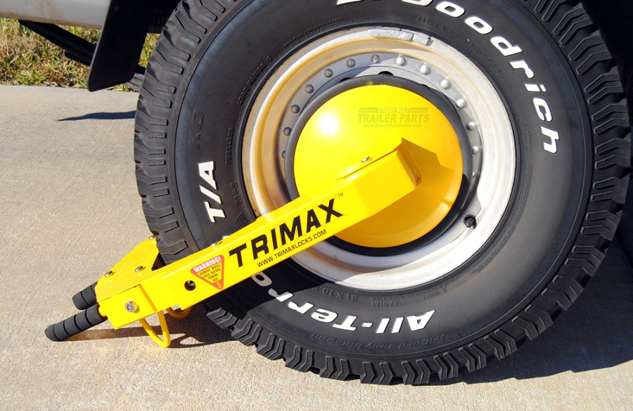 A wheel chock that covers the lug nuts is the hardest to remove. It's also the costliest but not nearly as costly as losing your trailer.