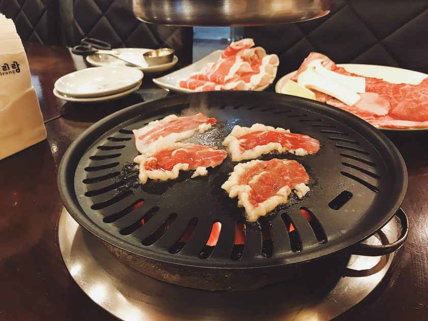 Thin-sliced marbled beef at Arirang
