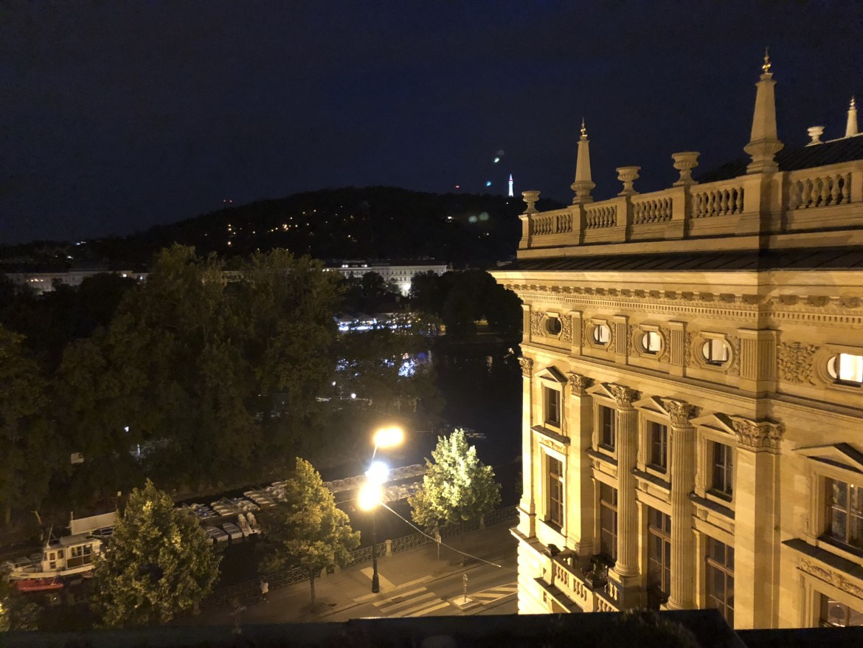 prague national theatre charles bridge vtara river at night from air b and b blog