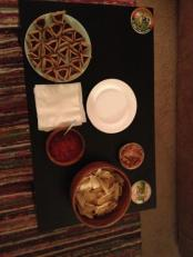 Sara's hamantaschen, chips and salsa, bean-and-chipotle dip I fashioned from leftover taquito filling.