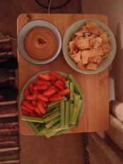 Homemade roasted red pepper hummus with veggies and pita chips.