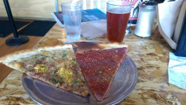 They have BRUNCH SLICES (as seen on the left). That's a Drugs Benedict with white bean and shallot spread, hash browns, tofu scramble and baco bits. At right is the Spiral Tap with caramelized onion spread, marinara and nooch. Washed down with a glass of local Laurelhurst brew.