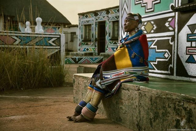 Esther Mahlangu sits at home