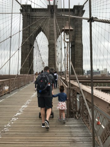Daddy walking his girls across The Brooklyn Bridge