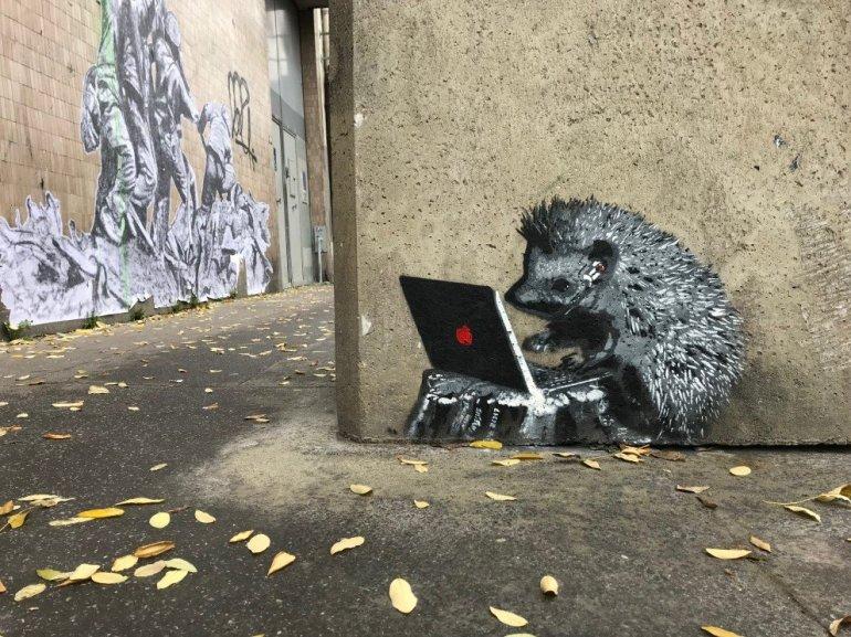 Parisian Street Art - Porcupine surfing the web on MacBook