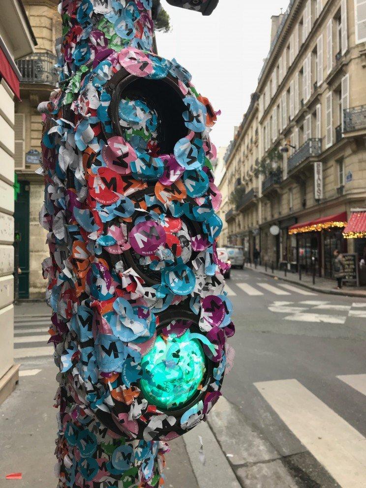 Parisian Street Art - sticker covered stop light