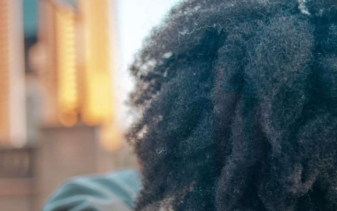 textured hair overlooking Abu Dhabi skyline