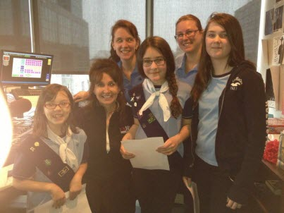 1st Fairview Guides visiting with FX101.9 host Denyse Sibley