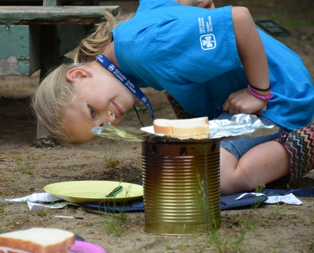 Girl with camp burner cooking