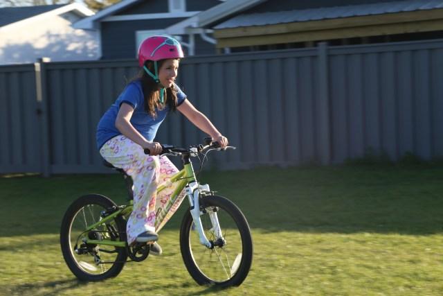 Guide riding a bike
