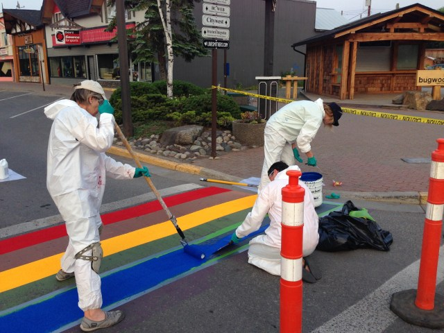 volunteers painting rainbow crosswalk