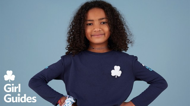 Girl Guide in blue uniform