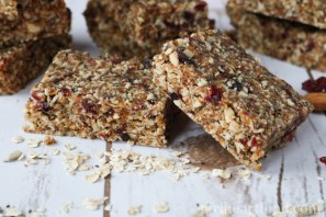 Easy homemade granola bars alongside some oats.
