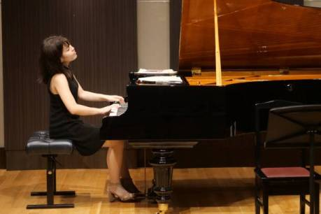 Pianist feeling the music. You will too after you take the Pianist's Guide to Fingering