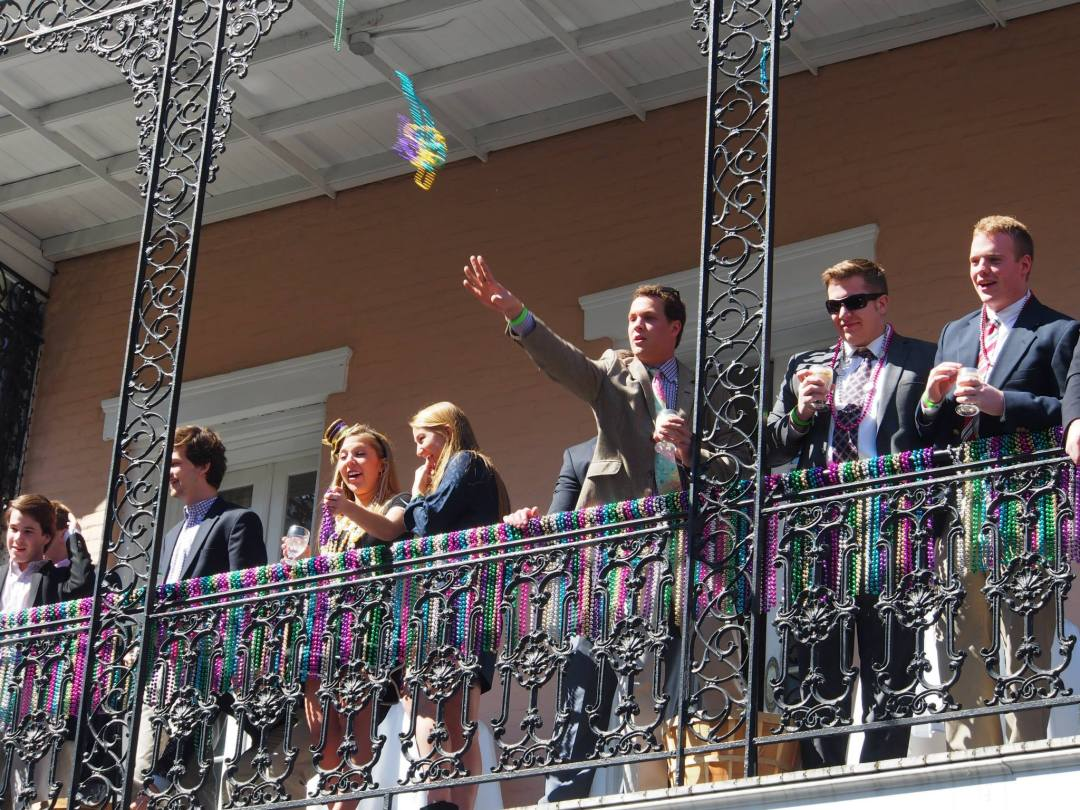 mardi-gras-throwing-beads-new-orleans