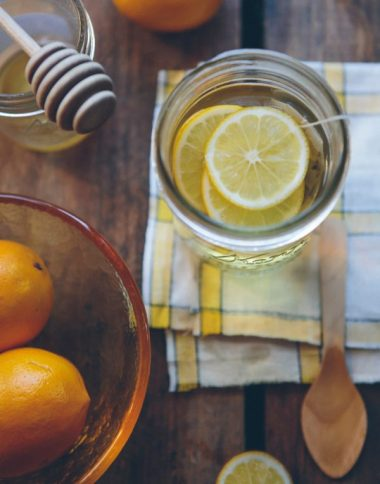 Lemon water with honey in a jar