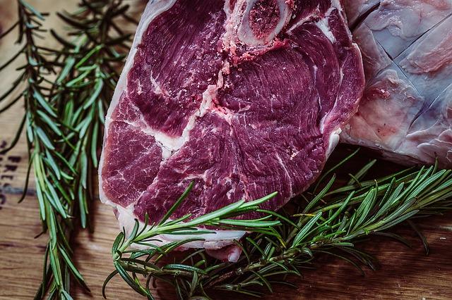 Raw steak with rosemary