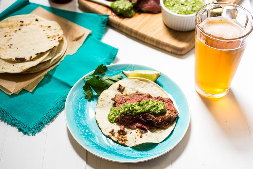 Beer Marinated Ancho Chili Spiced Lamb  with Cilantro Pesto | girlinthelittleredkitchen.com