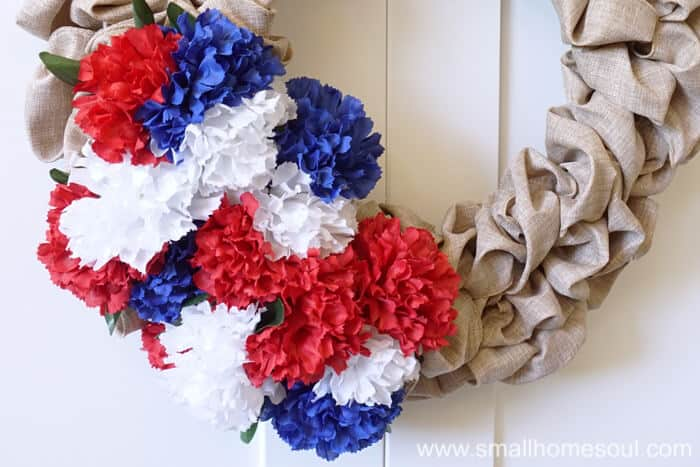Bunches of carnations make the July 4th Wreath pop for 4th of July.