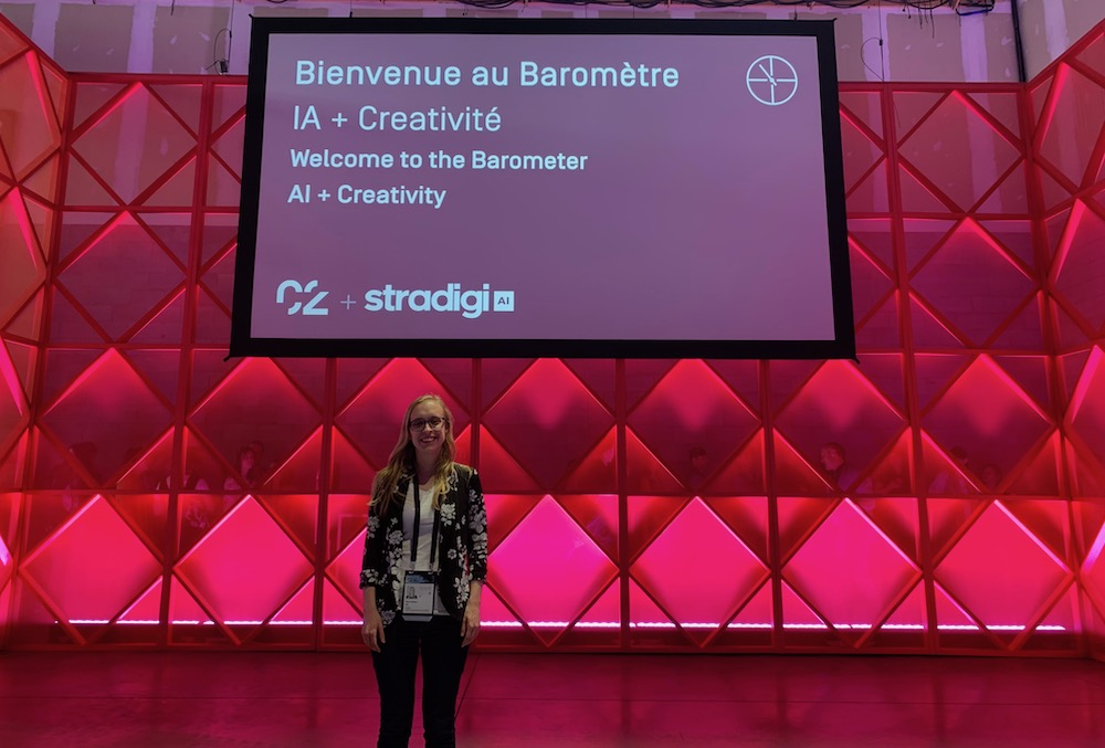 Marie-Philippe in front of the board where it's written Welcome to the barometer AI + Creativity