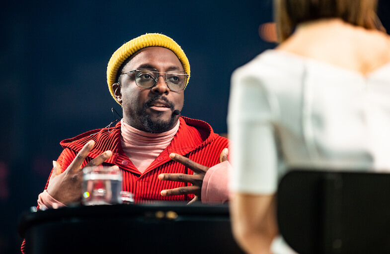 Will.i.am speaking on stage at C2 Montreal