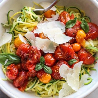 warm smashed tomatoes with zucchini noodles, olive oil and parmesan