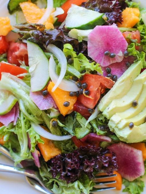 tropical green salad with papaya seed vinaigrette