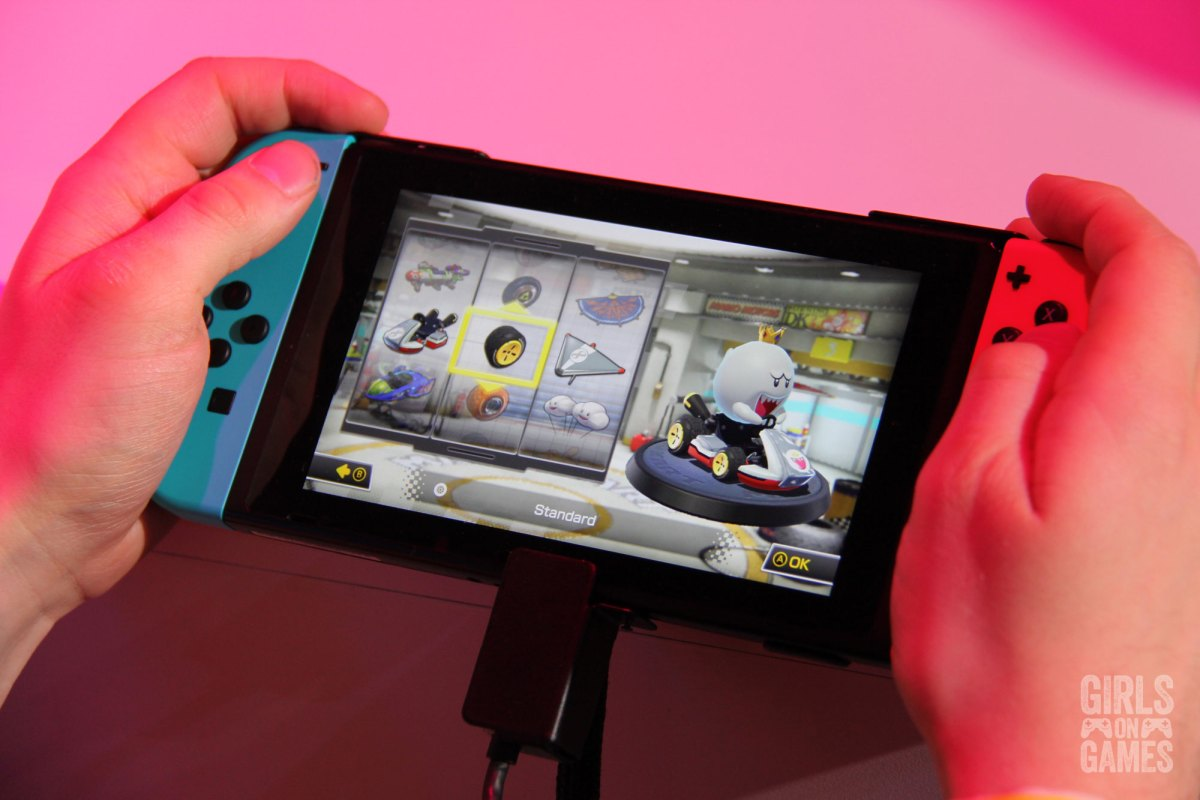Attendees playing Mario Kart 8 Deluxe on a Mario airplane at the Nintendo Switch event in Toronto. Photo: Leah Jewer / Girls on Games