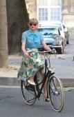Taylor Swift riding a bike in Paris