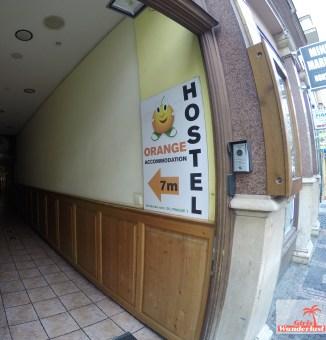 Hostel Orange Review Bad front sign.jpg