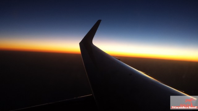 Sunset 1. How to survive a long-haul flight 40 Tips on traveling comfortable, drinks, food, and things to do..jpg