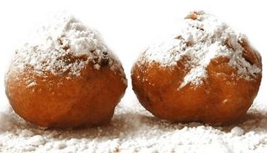 oliebollen. Dutch food bucket list - 30 Foods you must try in the Netherlands via @girlswanderlust.png