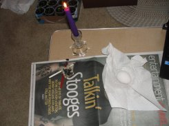 This is my battle station. The candle is used to heat the wax inside the tool, in order to liquefy it.