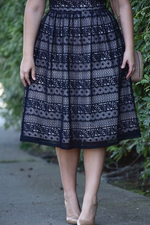 Girl With Curves wearing a Lace Dress from Maggy London at Nordstrom.