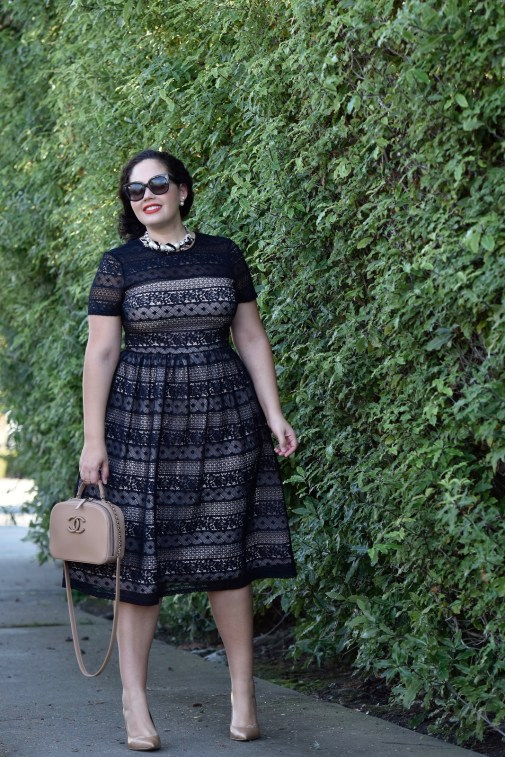 Girl With Curves wearing a pearl necklace from Ann Taylor, Audrey Sunglasses from Celine and Maggy London Lace Dress from Nordstrom.