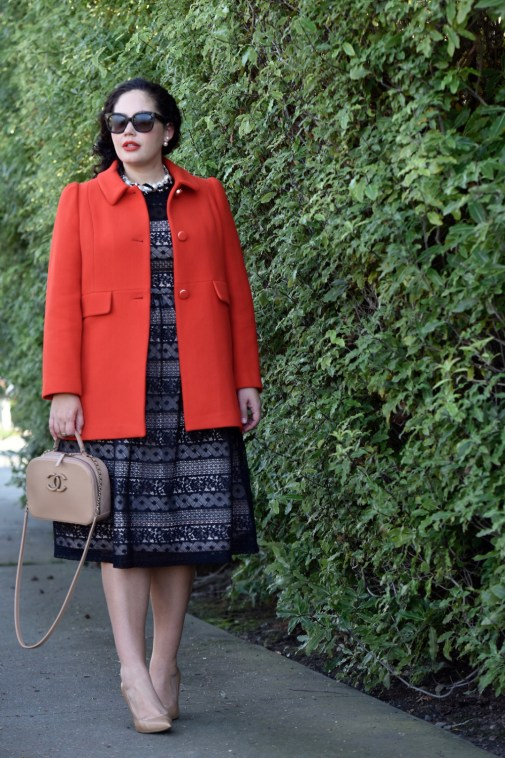 Girl With Curves wearing a pearl necklace from Ann Taylor, Audrey Sunglasses from Celine, Coat from Kate Spade, Lace Dress from Maggy London at Nordstrom, Chanel bag and Sam Edelman pumps.