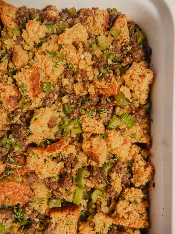 close up of cornbread dressing in a white baking dish