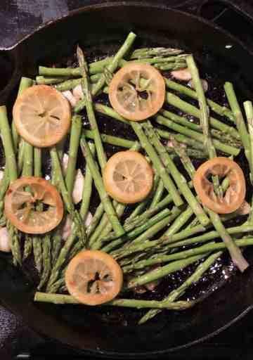 asparagus lemons garlic in cast iron skillet