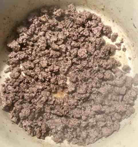 ground sirloin being cooked in a dutch oven