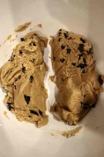 divided cookie dough with chocolate chips in a white bowl