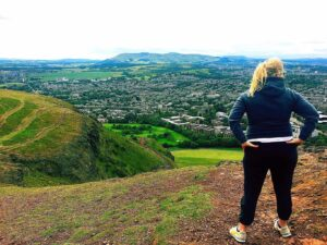This view is what make's a hike up Arthur's Seat one of the best free things to do while backpacking Edinburgh.