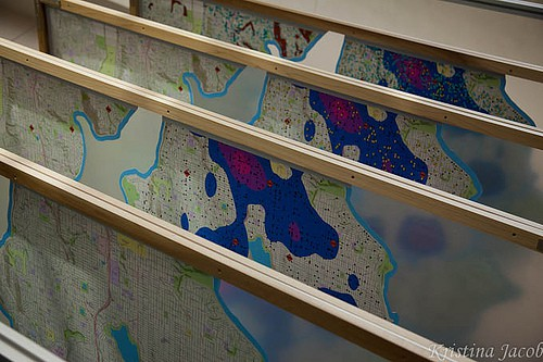 An exhibit of map layers at the San Diego Convention Center.