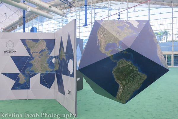 The Map Gallery features maps by users around the world. Esri's Dymaxion map projection hanging in the Sails pavillion this year.