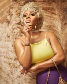 Toke Makinwa And A Troll Who Believes Her Ex Gave Her Fame Say, Both Of You Are Insane