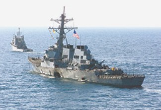 The USS Cole after it was attacked by suicide bombers in October 2000 in Yemen. (Photo courtesy of United States Marine Corps)