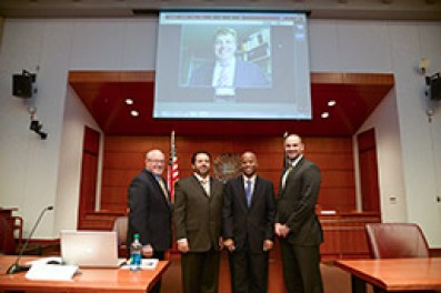 An IU McKinney symposium examined trials at Guantanamo Bay. Panelists included (from left): Richard Kammen, Kammen & Moudy; Shahram Dana, The John Marshall Law School; George Edwards, IU McKinney; and Paul Babcock, editor-in-chief of the Indiana International & Comparative Law Review. Chris Jenks of Southern Methodist University Dedman School of Law participated via video link. (Photo by Dave Jaynes, courtesy of IU McKinney Law)