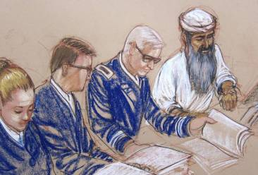 This Pentagon approved sketch by court artist Janet Hamlin shows Hadi al Iraqi during his arraignment in June 2014. Second from the left is Hadi's now former counsel, Air Force Major Ben Stirk.